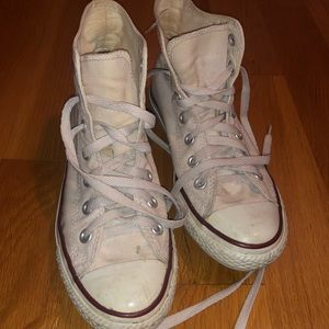 Worn white high top converse!